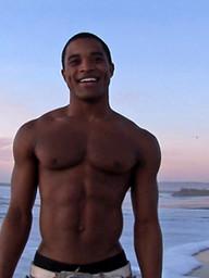 Ebony jock Landon shows his perfect abs and hard cock
